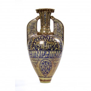 "An earthenware copper-lustre and blue Alhambra Amphora Vase or 'albarello' (pharmacy jar) dates to the second half of the nineteenth century. The distinctive tapered form, decorated overall with scrolling foliage and gazelles, the centre with a band of stylized pseudo Arabic characters with inverted pear-shaped body and wing-like flat handles, is based on a fourteenth century prototype. The Alhambra which is in Granada Andalucia, Southern Spain ""A royal city of a great population…"". this was the era of the Nasrid Dynasty (reigned 1232-1492), the Muslim rulers responsible for the construction of the Alhambra palace in Granada. The lustre technique reached Spain from other Islamic centres in the east, particularly Iraq, Egypt and Persia. During the nineteenth century Andalucia became an important destination for travellers, fascinated by the rich remains of Spain's Islamic past. Entrepreneurial potters, including the Frenchman Theodore Deck, created replicas of the famous 'Alhambra Vases.' These works were produced to an incredibly high standard, perfectly imitating the coppery lustre and cobalt blue highlights on the fourteenth century originals. Even the decorative motifs were closely copied and this example includes a pair of confronting gazelles, panels of split-leaf arabesques and bands of calligraphy. It is a superb witness to the nineteenth century fascination with 'oriental' and historic styles. - (ADC.185) Height 36cm Diameter 19cm"