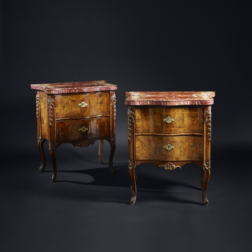 A fine pair of walnut veneered, parcel gilt, marble topped commodini. Rome circa 1750 A very good pair of mid 18th century Roman walnut veneered and parcel gilt two drawer serpentine shaped commodes with wonderful Sicilian Jasper (Diaspro tenero di Sicilia) veneered tops. The quarter veneered, serpentine shaped marble tops with rolled moulding and crossgrain edge, supported by tall walnut, pine and poplar carcased, walnut veneered cabinets. Each side with a central figured walnut panel and a straighter grained inlaid border surrounded by further cross-banding. The serpentine shaped drawers with similar figured walnut panels surrounded by cross-grain borders. The legs and lower frieze with carved shell and acanthus leaf decoration and gilded highlights. This wonderful pair of commodini are not only beautiful for their design and use of materials but are also in a lovely state. Aside from the replaced escutcheons, they have had very few repairs and remain in an excellent original condition. Provenance: Conti Bianconcini-Persiani, Bologna.