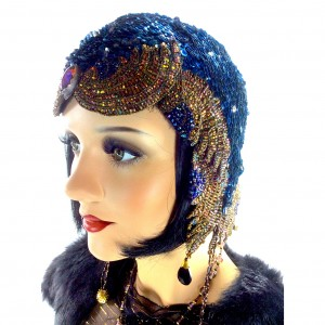 1920 beaded flapper evening cloche featuring electric blue sequins with peacock iridescent glass beading along edging. Such a unique shape to this museum-quality piece.