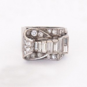 A 1940's Diamond Ring featuring baguette and round cut diamonds in platinum on a tapered band.