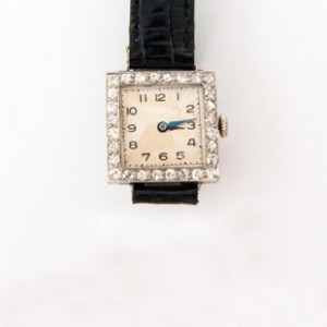 A Lady's Diamond and Platinum Wrist Watch. Square case with surrounding diamonds. Circa 1925.