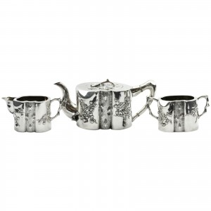 Chinese export Wang Hing prunus tea set An unusual late 19th century three-piece Chinese export coin silver tea service by famed Hong Kong silversmiths Wang Hing. The piece features a heavy prunus motif, with the centre of each piece representing the grain, whilst the spout and handle represent the branches.