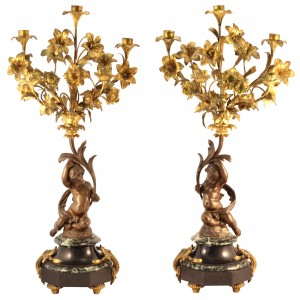 Putti candelabra A pair of Louis XVI style marble based bronze candelabra, featuring cast putti, and gilt branches.