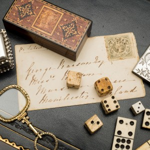 Tunbridge ware stamp box c.1860 // Gold cased quizzing glass c.1820 // Collection of various bone and Perspex dice // HMSS aesthetic design vesta case Birmingham 1883 // HMSS small box with engraved knight Birmingham 1895 // Double nine whalebone and ebony dominoes from a complete set, 19th century.