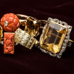 Citrene and 18ct ring with carved shoulders c. 1960 // Art Deco carved coral plaque ring in 18ct and platinum with diamond set shoulders, c. 1930 // Large carved coral knot set at the centre with an old cut diamond on contemporary 9ct rose gold shank // Contemporary 18ct yellow and white gold ring invisibly set with 3.58 carats of baguette cut yellow // Rectangular citrene ring in 9ct yellow gold c1960 - Large citrene ring in 18ct yellow gold, with carved white gold setting c. 1930-50.