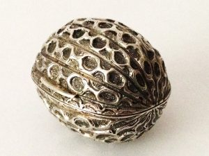 Lafite Fine Silver A very rare Victorian naturalistic silver nutmeg grater, modelled in the form of a nutmeg or mace, the hinged cover opening to reveal a blue steel rasp, by Hilliard and Thomason, Birmingham 1871.