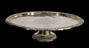 Lafite Fine Silver A magnificent Queen Anne Britannia Standard silver footed salver or tazza, of comparatively large size, with contemporary arms, Edward Gibbon, London 1705.
