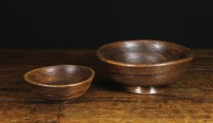 Westbury Antiques Pair of 19th Century turned Treen Bowls. One raised on a pedestal foot 11cms high, 27cm diameter, the other 7cms high, 18.5 cms diameter. Circa 1820.