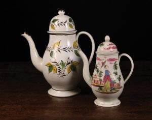Westbury Antiques A large Yorkshire Pearlware pottery baluster coffee pot. Height 28cms. Circa 1790. A small pottery Pearlware coffee pot decorated with a chinoiserie scene of mother and child in a garden and pagoda to other side. Height 21.5cm. Circa 1790.