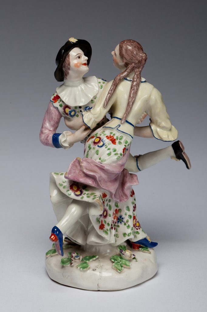 "Etruria Antiques Gallery Bow Porcelain Harlequin dancing with Columbine: two figures from the Commedia dell'arte. 7.5"" high, circa 1754. From the Barry & Joan Taylor Collection."
